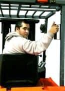 Ergonomic forklift back up handle